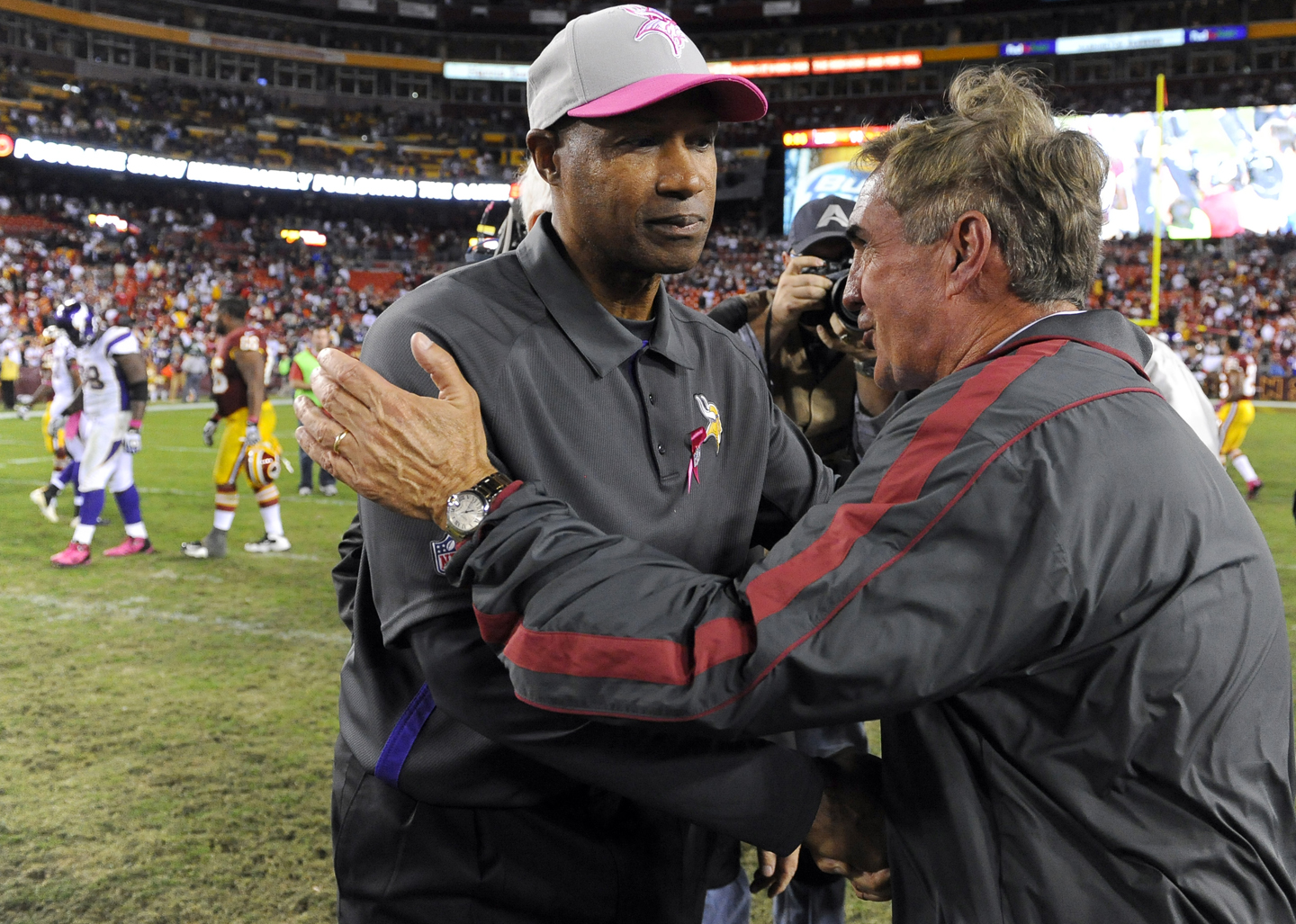 Minnesota Vikings head coach Leslie Frazier is greeted at midfield by Washington Redskins head coach Mike Shanahan after an NFL football game, Sunday, Oct. 14, 2012, in Landover, Md. Shanahan beat out Frazier for the head coaching job with the Redskins in 2010.