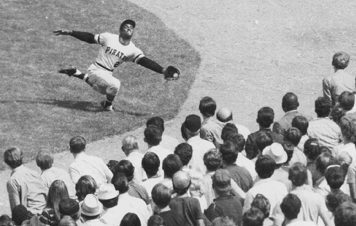 Pittsburgh Pirate Roberto Clemente robs New York Mets' Cleon Jones of a hit at New York's Shea Stadium, Sept. 21, 1970. The Mets won the game, 4-1.