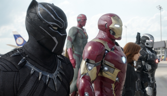 "This image released by Disney shows, from left, Chadwick Boseman as Panther, Paul Bettany as Vision, Robert Downey Jr. as Iron Man, Scarlett Johansson as Natasha Romanoff, and Don Cheadle as War Machine in a scene from ""Marvel's Captain America: Civil War."""
