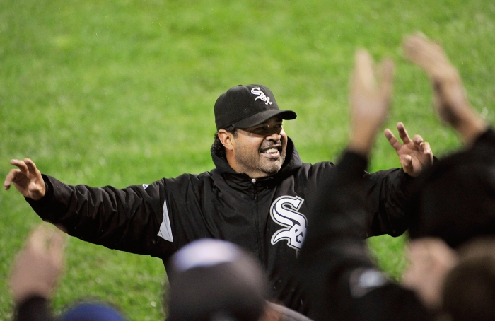 Ozzie Guillen #13 of the Chicago White Sox waves to the crowd after the White Sox defeated the Toronto Blue Jays 4-3 at U. S. Cellular Field on September 26, 2011 in Chicago, Illinois. The White Sox agreed to Guillen's request to be released from his contract, allowing him to pursue other opportunities.