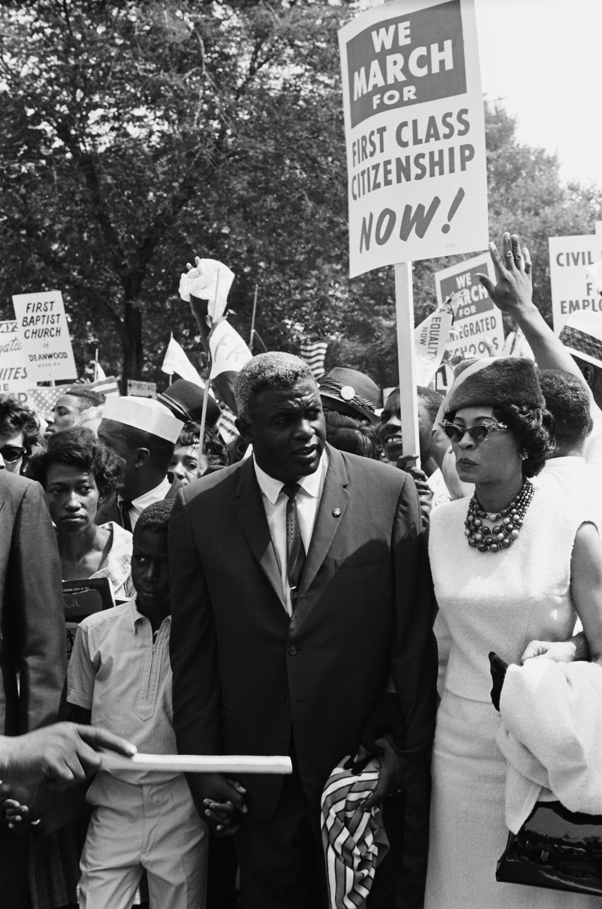 Son David Robinson, baseball player Jackie Robinson, wife Rachel Robinson during the March on Washington for Jobs and Freedom political rally in Washington, DC on August 28, 1963