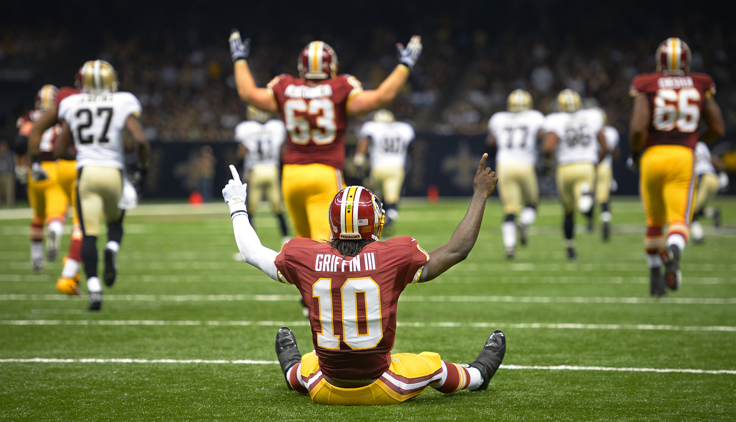 NEW ORLEANS LA SEPTEMBER 9: Redskins quarterback Robert Griffin III (10) celebrates his first NFL touchdown after he got knocked down on a short pass play to wide receiver Pierre Garcon (88), who went 89 yard for a 1st quarter touchdown as the Washington Redskins defeat the New Orleans Saints 40 - 32 at the Mercedes-Benz Superdome in New Orleans LA September 9, 2012 (Photo by John McDonnell/The Washington Post via Getty Images)