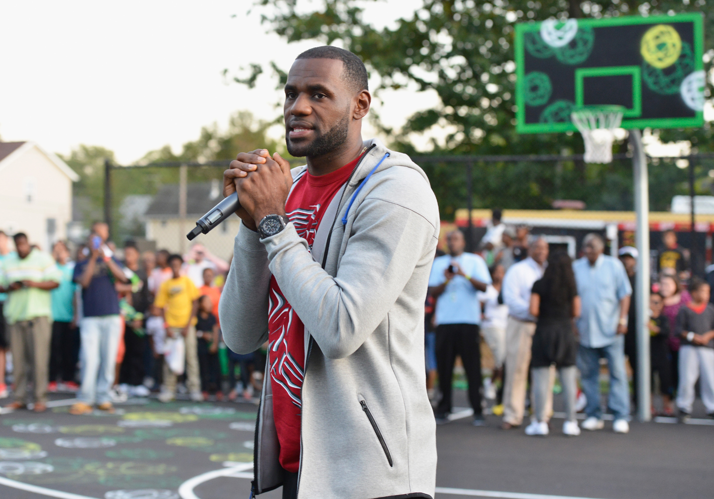 AKRON, OH - SEPTEMBER 25: LeBron James joined Sprite to reveal two refurbished outdoor basketball courts with painted artwork by Futura at Patterson Park on September 25, 2014 in Akron, Ohio. (Photo by Duane Prokop/Getty Images for Sprite)