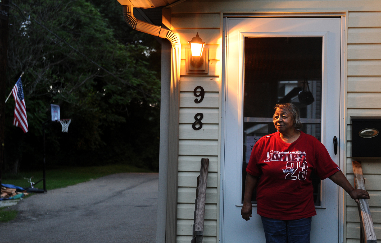 AKRON, OHIO AUGUST 27, 2014-Wanda Reaves, who once housed Lebron James as a child, stands at her front door on Overlook Place in Akron, Ohio. (Photo by Wally Skalij/Los Angeles Times via Getty Images)