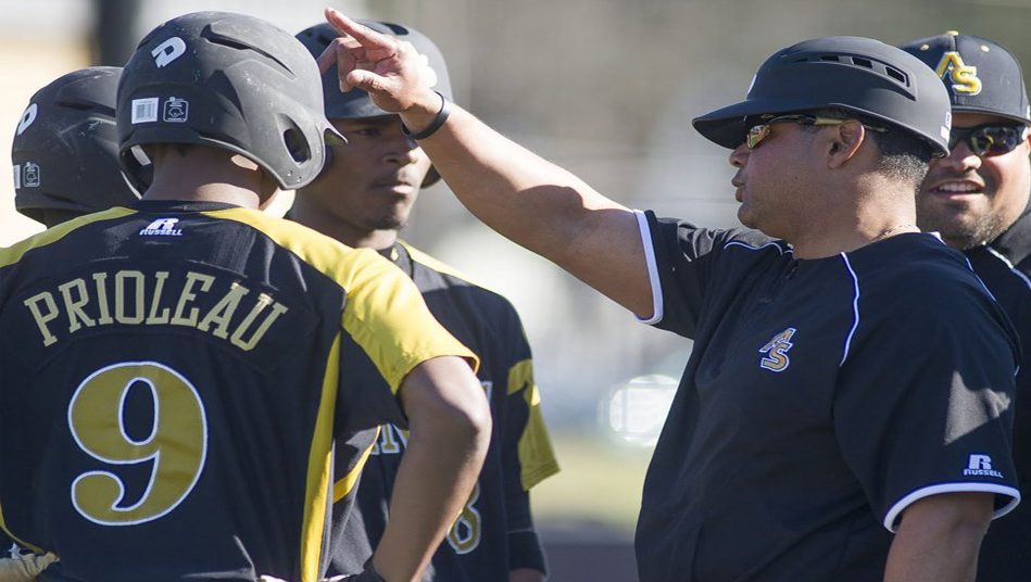 Alabama State University baseball coach Mervyl Meledez talks with his team.