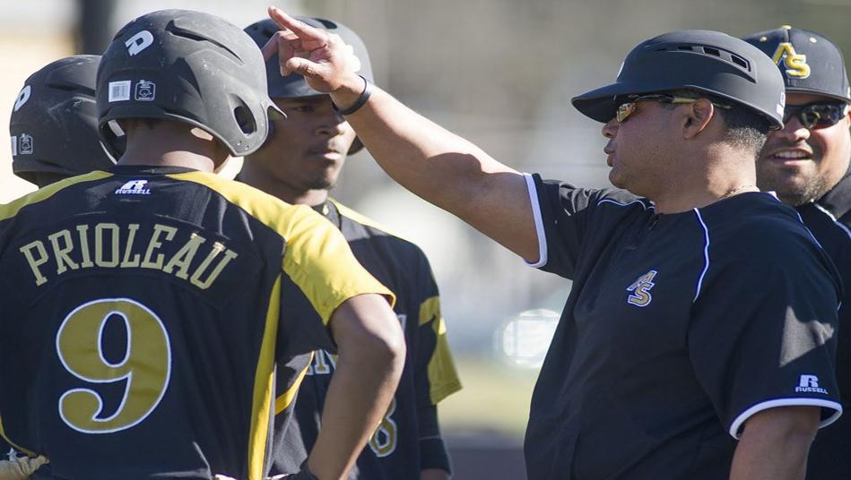 Alabama State University baseball coach Mervyl Meledez talks with his team.