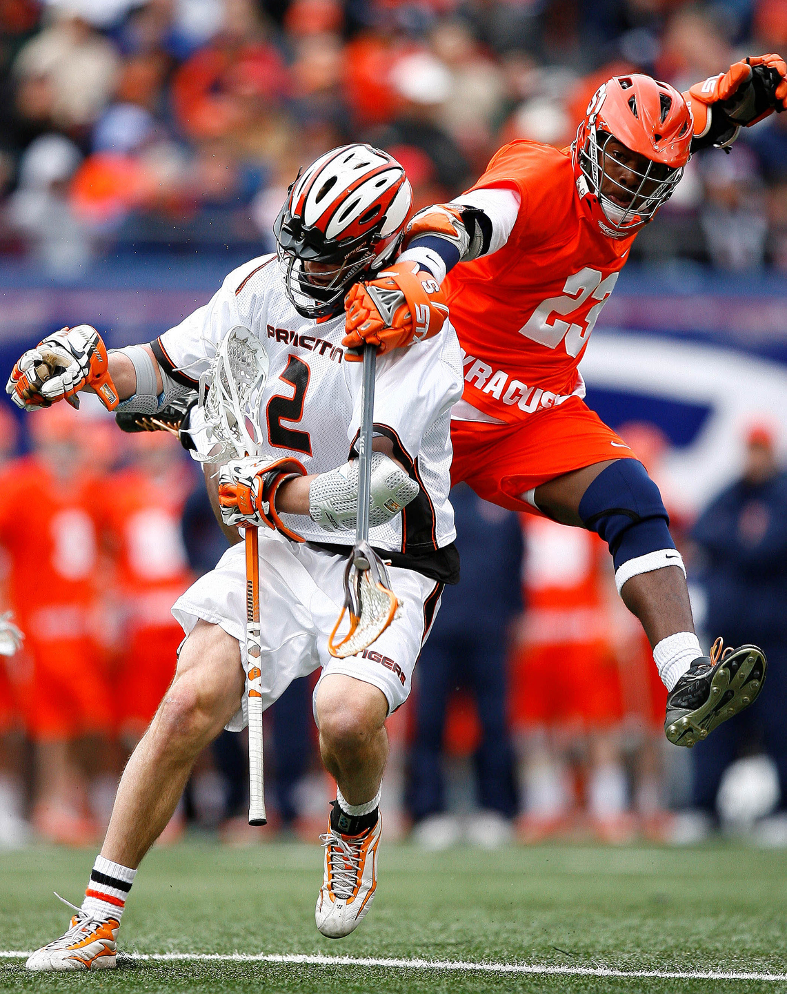 Princeton Tigers attacker Scott Mackenzie (2) brings the ball up field during second half action against Syracuse Orange midfielder Jovan Miller (23) at the Big City Classic in Giants Stadium.