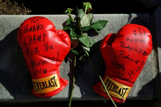 Boxing gloves with well wishes are left at a makeshift memorial for late boxing champion Muhammad Ali in Louisville, Kentucky