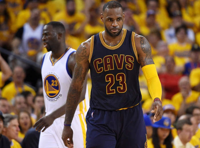 Cleveland Cavaliers forward LeBron James (23) reacts during the third quarter against the Golden State Warriors in game two of the NBA Finals at Oracle Arena.