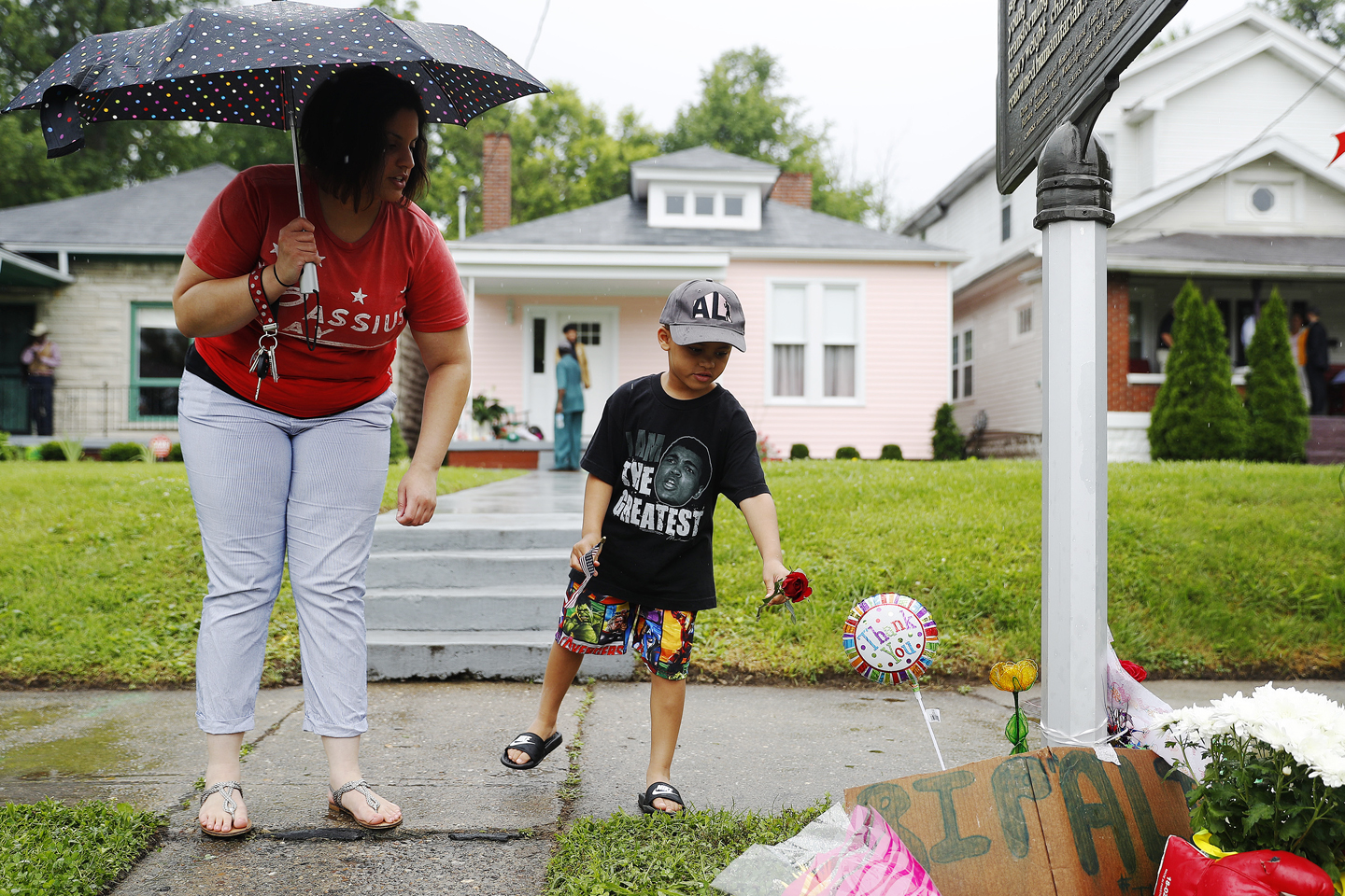 Mourners leave flowers outside Muhammad Ali's childhood home following his death June 4, 2016 in Louisville, Kentucky. Ali died at a Phoenix-area hospital, where he had spent the past few days being treated for respiratory complications.