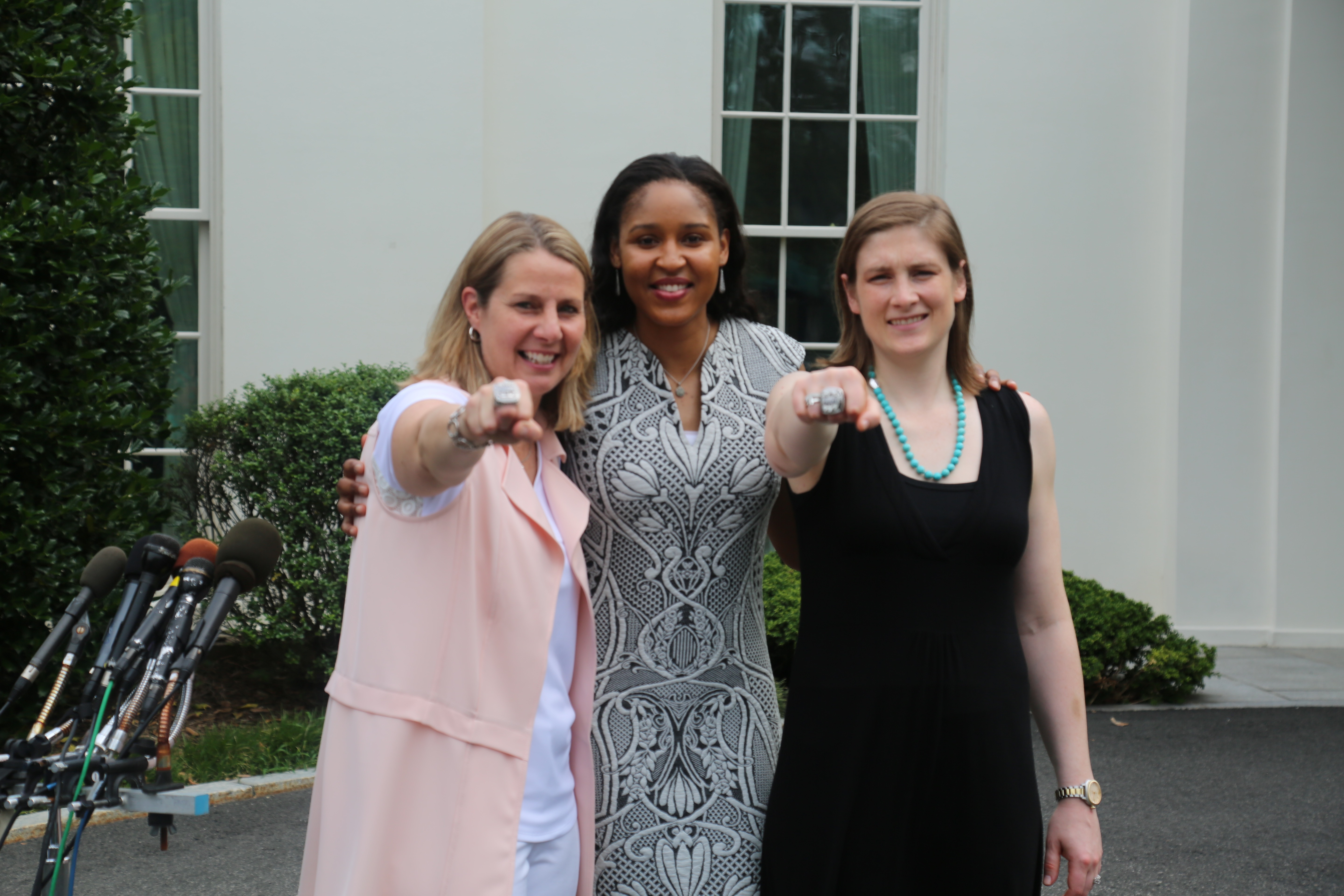 Minnesota Lynx Coach Cheryl Reeves, forward Maya Moore and guard Lindsay Whalen show off their 2015 WNBA championship rings.
