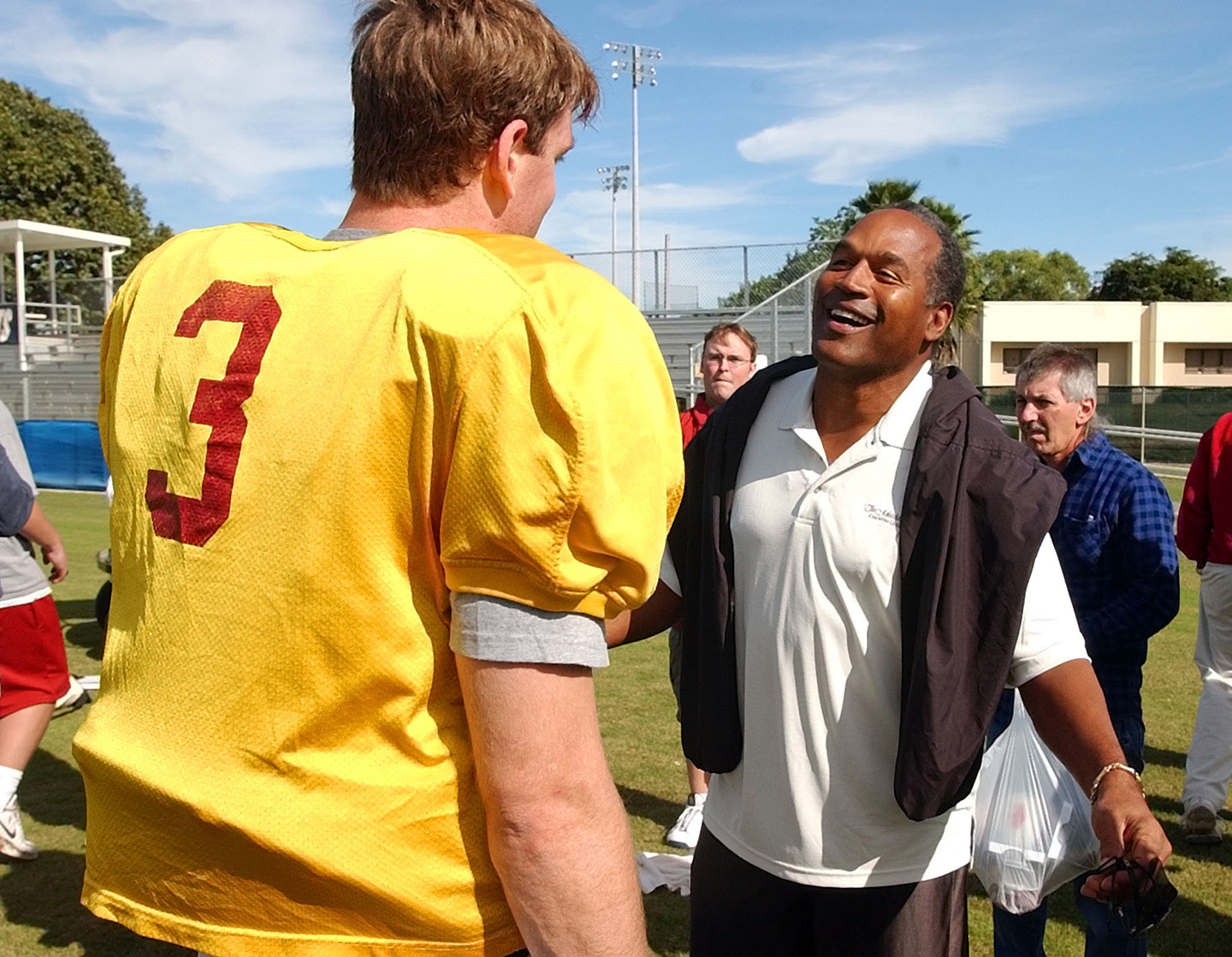 University of Southern California quarterback Carson Palmer talks to former football great O.J. Simpson after practice for the Orange Bowl game Saturday, Dec. 28, 2002 in Davie, Fla. The two are winners of the Heisman trophy.