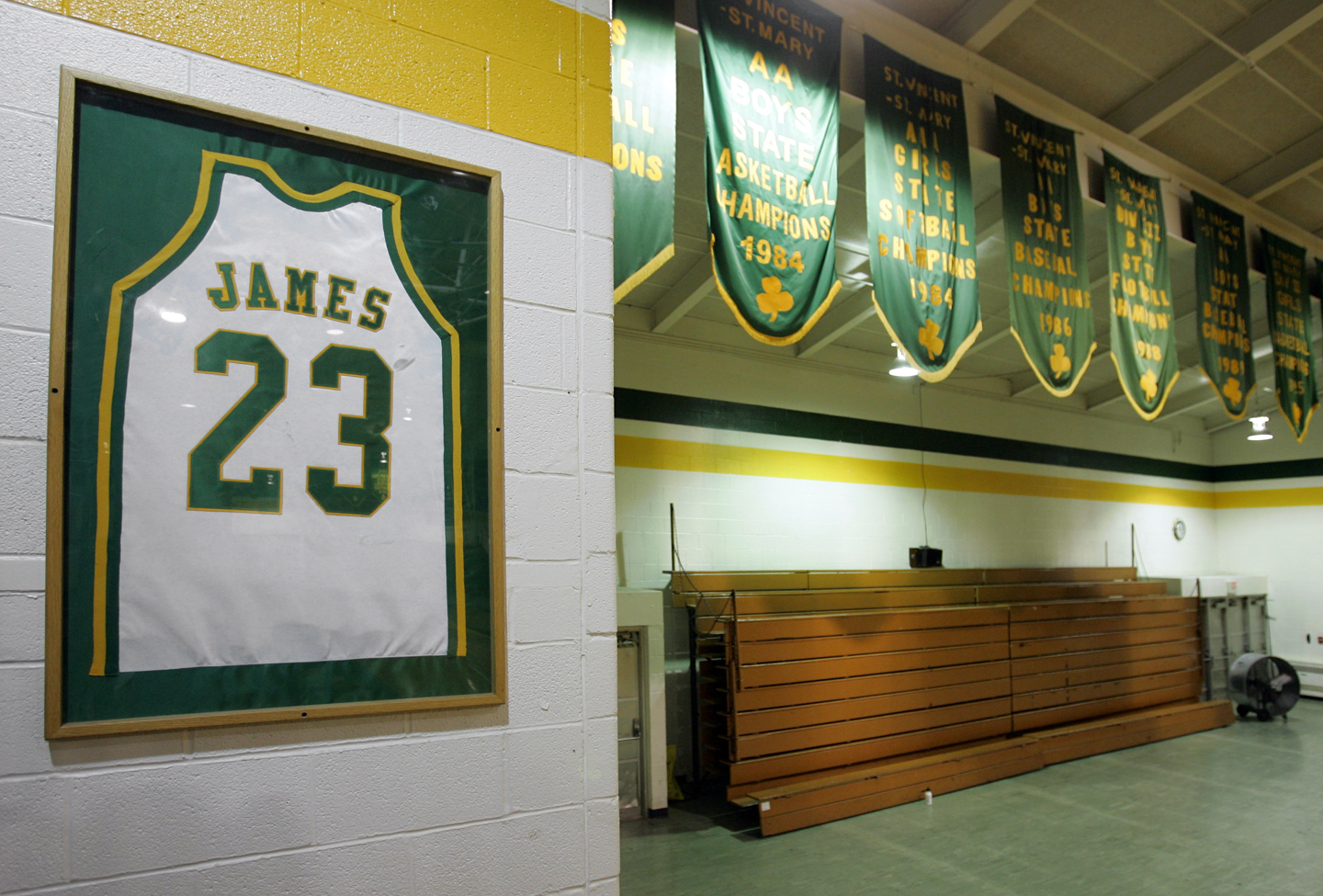 The retired jersey of LeBron James hangs in the gym at St. Vincent-St. Mary High School in Akron, Ohio next to the school's championship banners Friday, June 8, 2007.