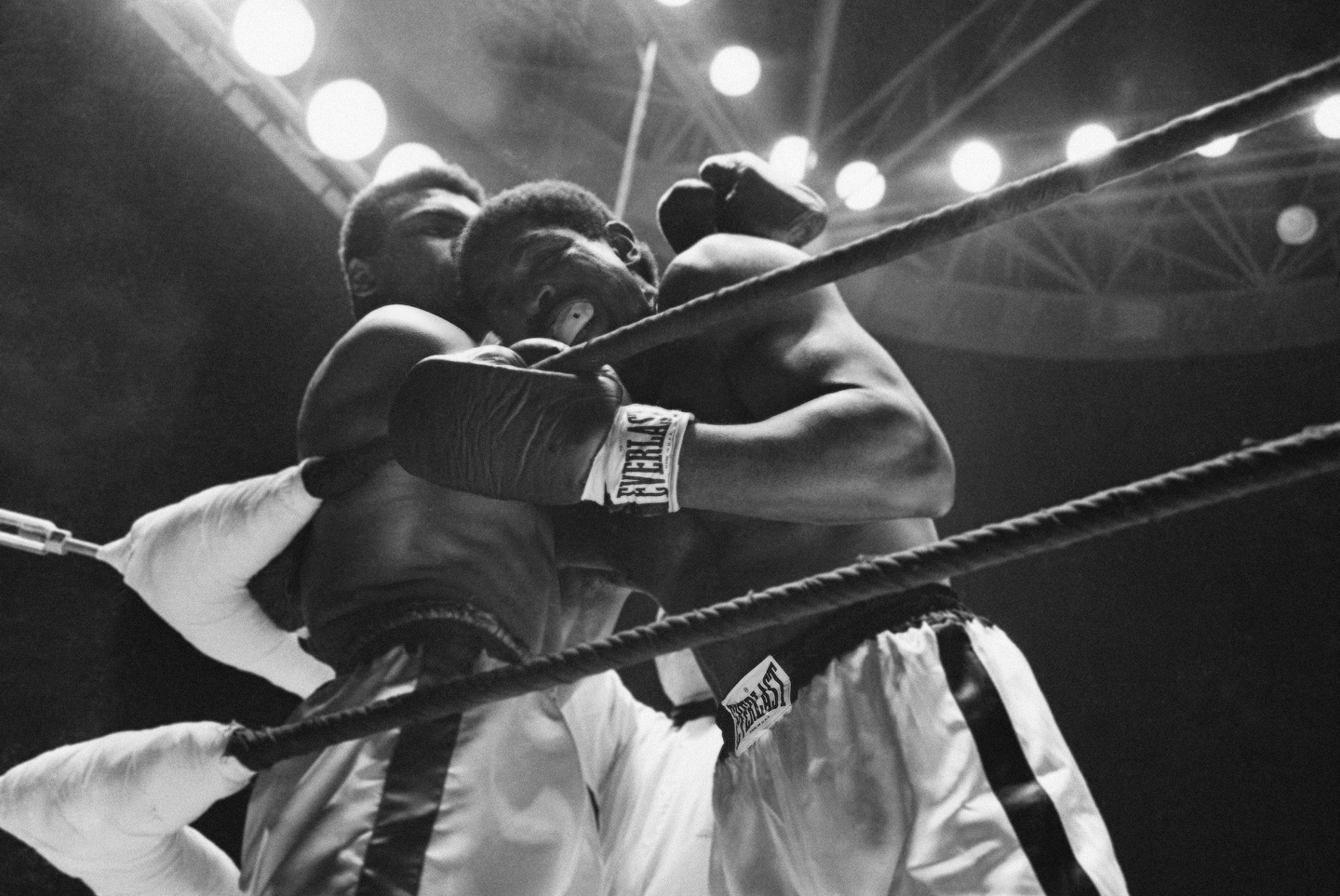 Ernie Terrell is bent over the ring rope by Muhammad Ali in the third round of their heavyweight title bout on Feb. 6, 1965 in Houston. Terrell suffered an eye injury that he said affected his vision and was caused by Ali rubbing his face across the rope.