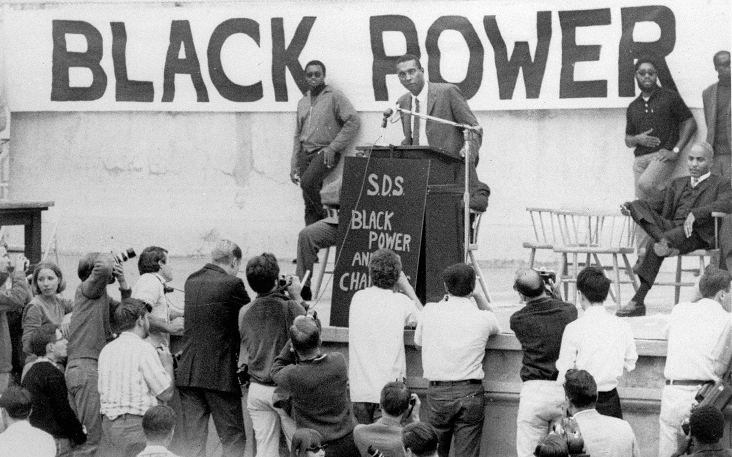 "Stokely Carmichael, 25, head of the Student Nonviolent Coordinating Committee, speaks at the University of California's Greek Theater, Berkeley, California, October 29, 1966, jammed with 14,000 people. Carmichael at the rostrum, said: ""To hell with the draft."""