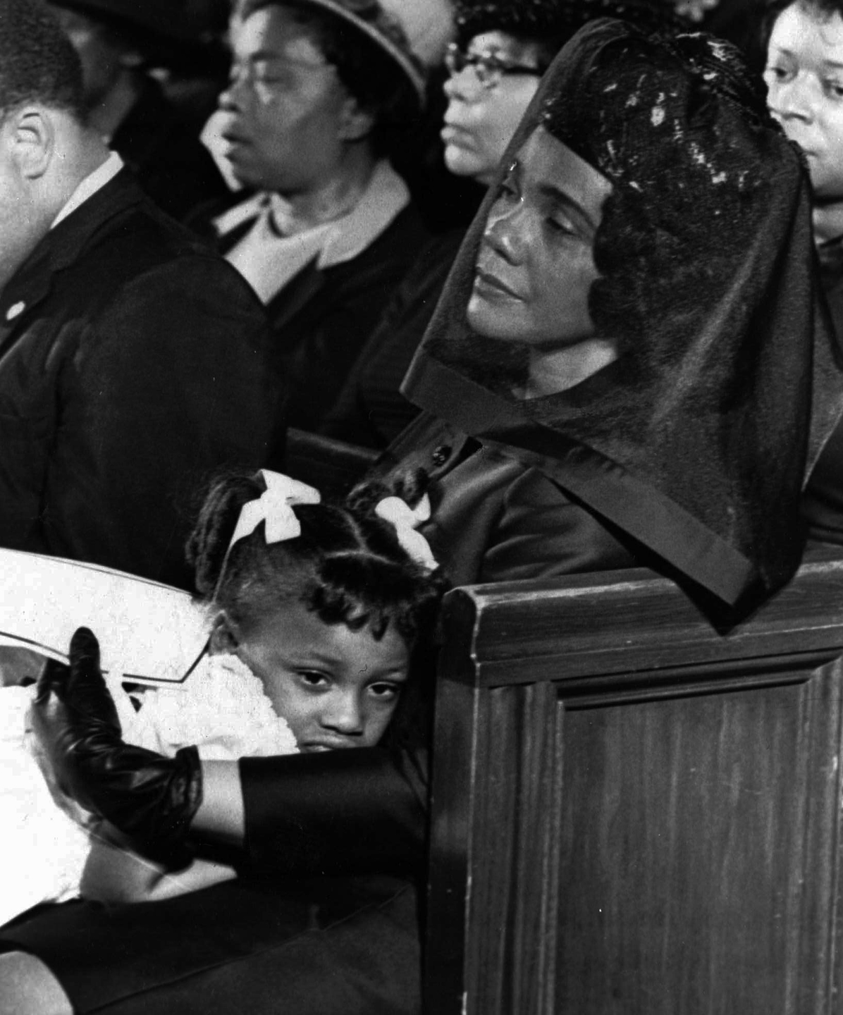 Coretta Scott King and her daughter, Bernice are shown April 9, 1968, in Atlanta, Ga. attending the funeral of her husband, Martin Luther King, Jr., in this Pulitzer-prize winning photograph taken by Moneta J. Sleet, Jr., the first African-American to win a Pulitzer Prize for photography.