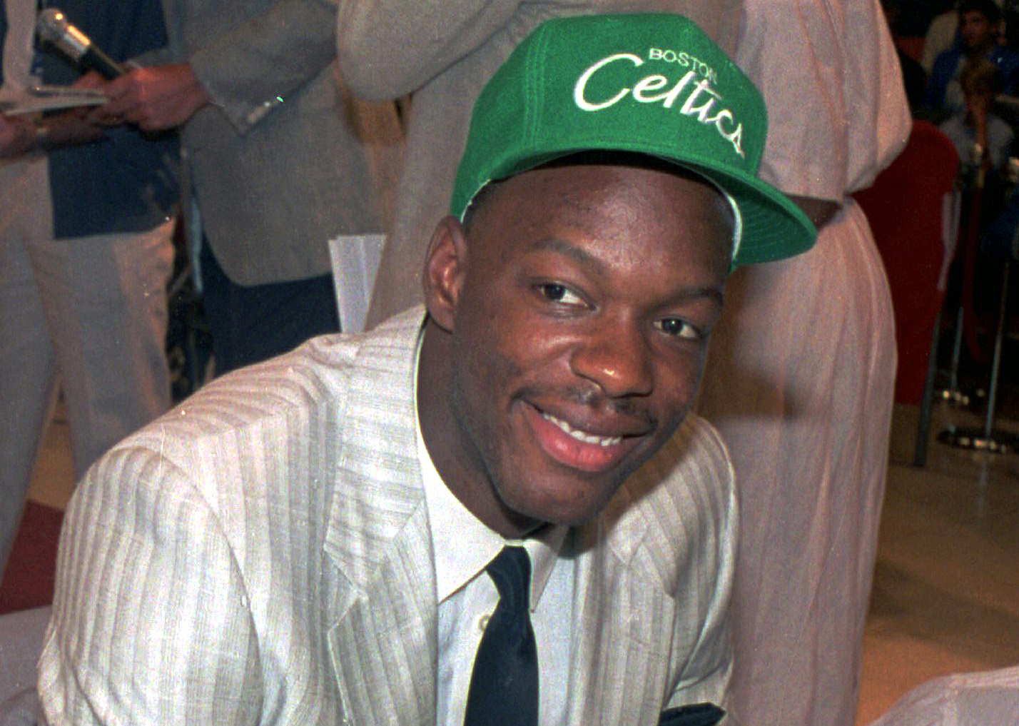 Len Bias wears a Boston Celtics hat after being selected as the No. 2 pick in the NBA draft in New York, June 17, 1986.