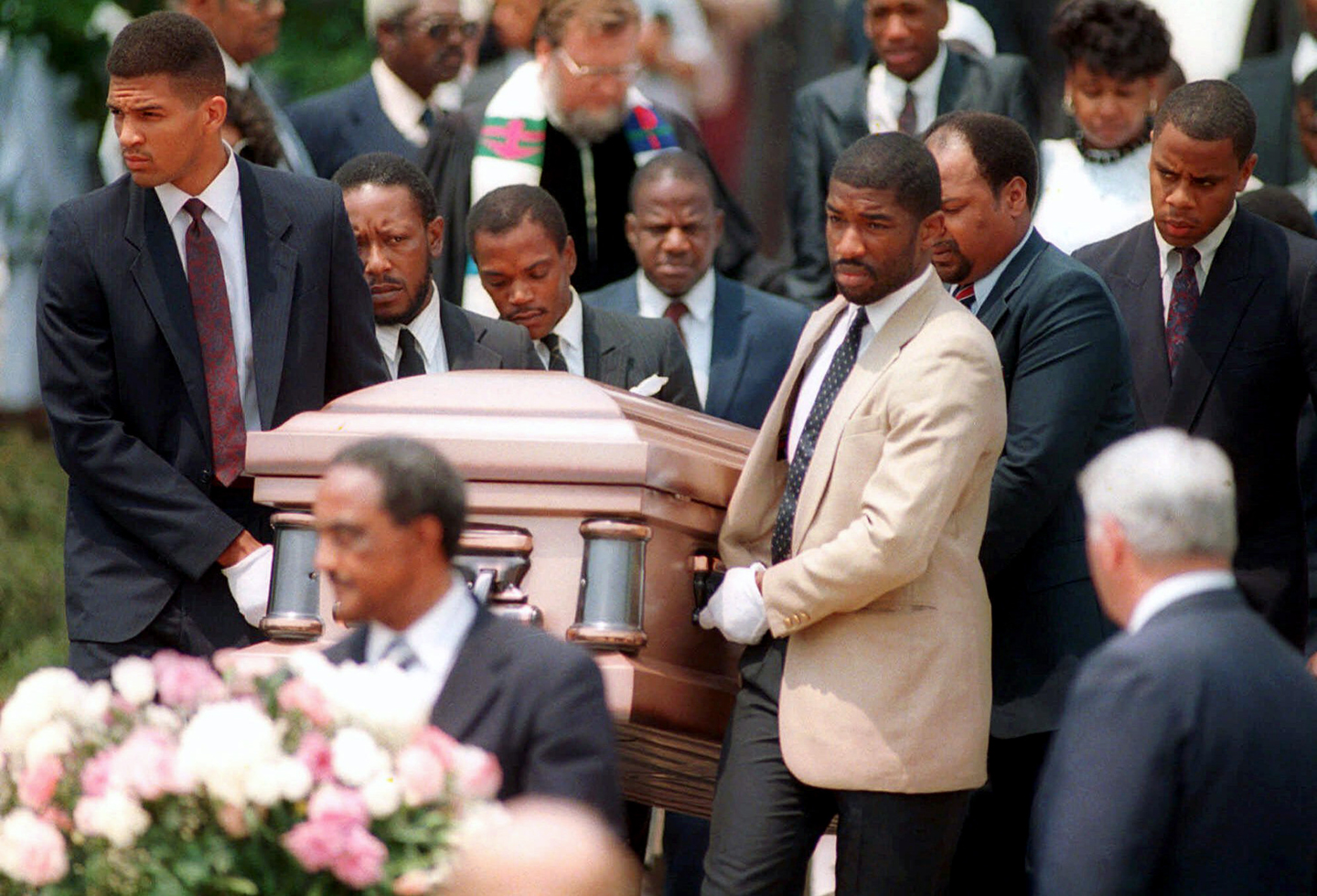 Friends of the late University of Maryland basketball star Len Bias, carry his casket from the college chapel in this June 23, 1986 photo, after a private funeral.