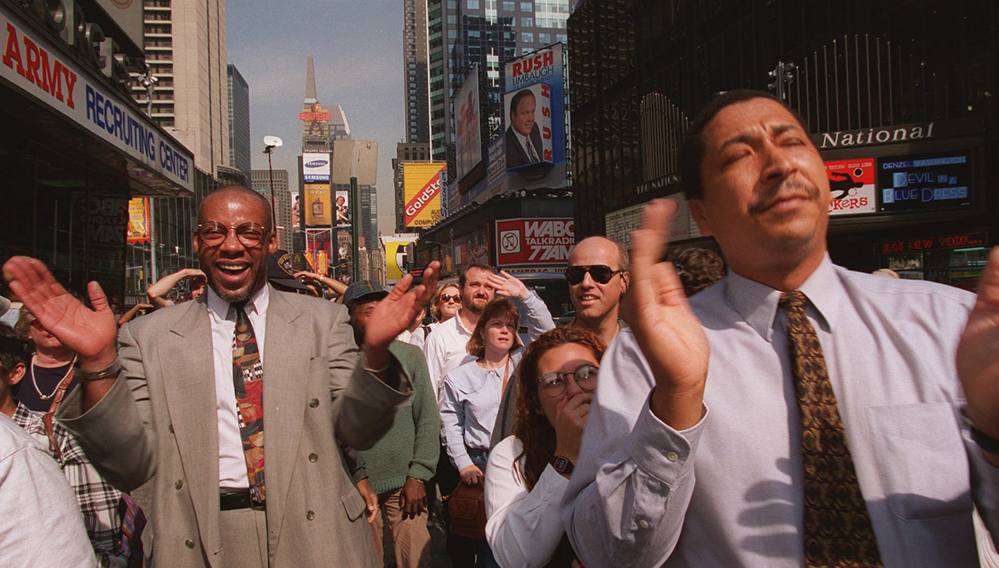 Part of a crowd of pedestrians react as they watch the Jumbotron television screen in New York's Times Square, Oct. 3, 1995, and the news that O.J. Simpson was found not guilty of killing Nicole Brown Simpson and Ronald Goldman.