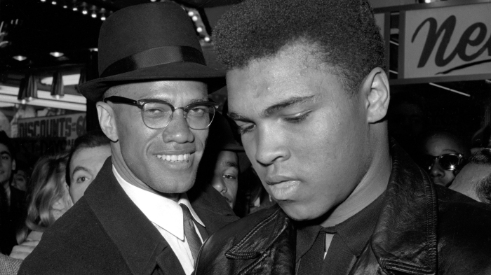 Why did Malcolm X convert to Islam?