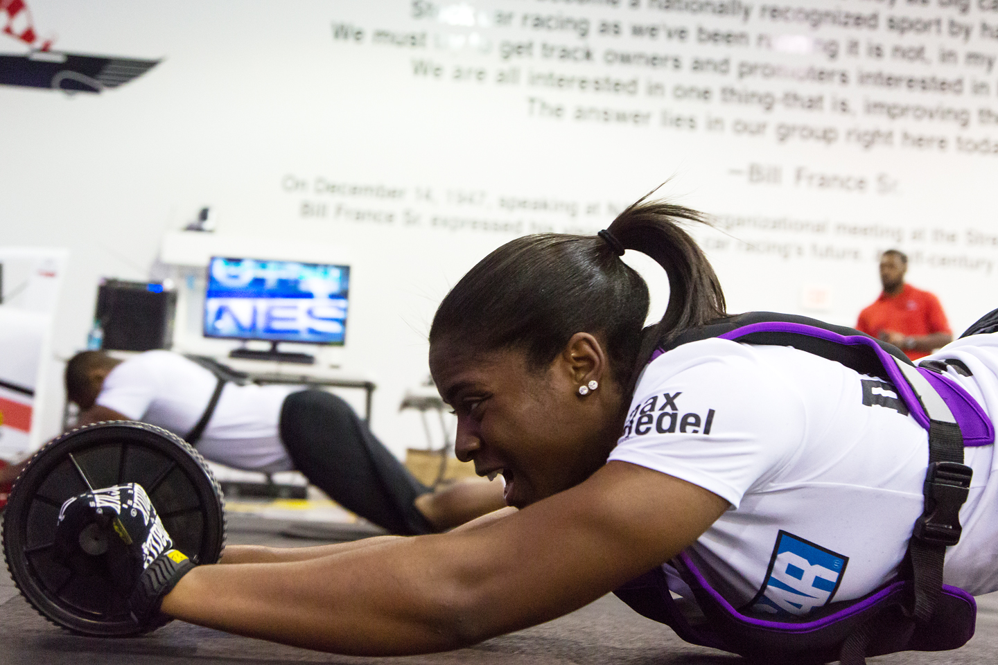 Brehanna Daniels demonstrates core strength skills and conditioning portion of the Drive For Diversity Pit Crew Combine at the NASCAR Research & Development Center in Concord, NC.