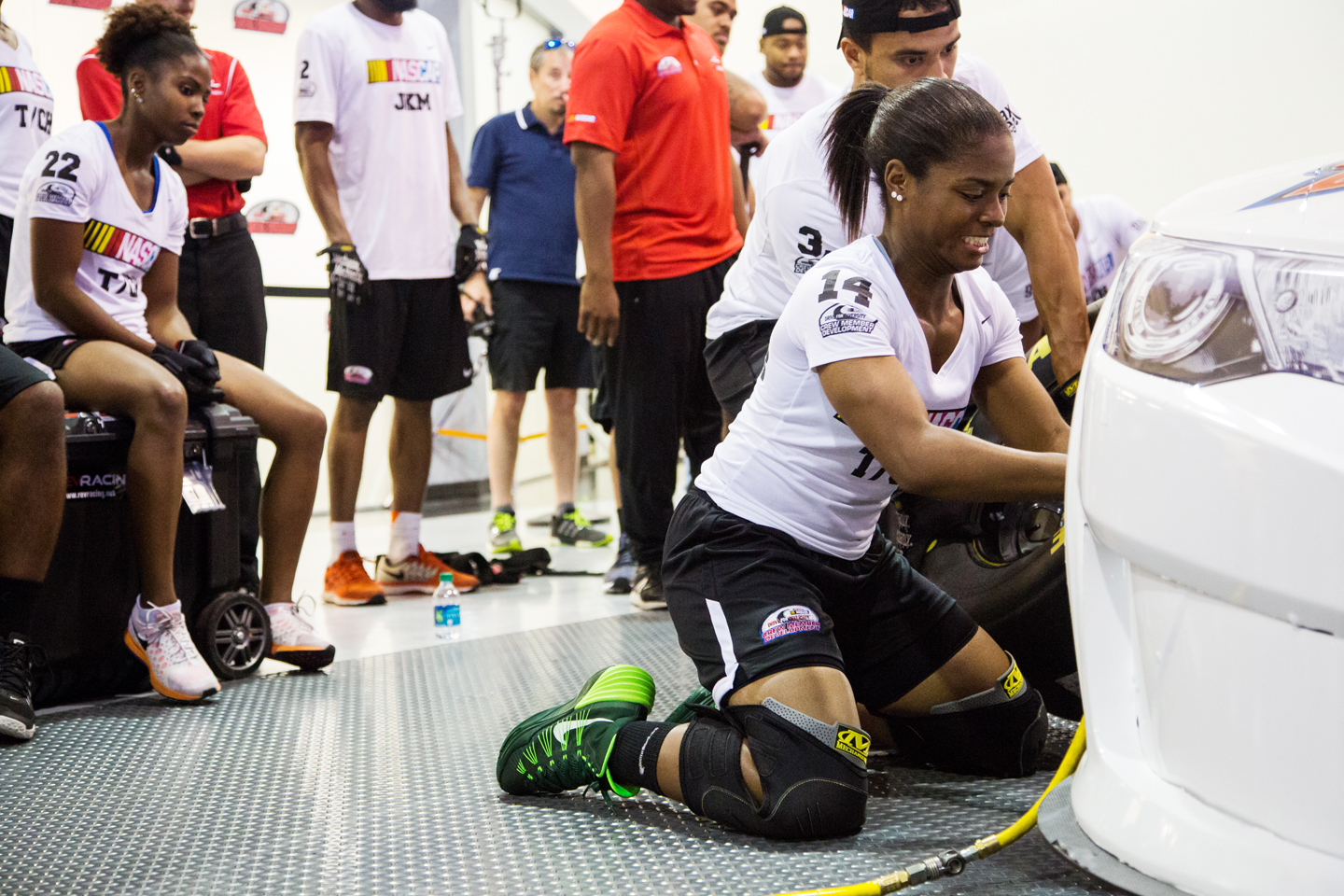 Brehanna Daniels practices at front tire changer during the Drive For Diversity Pit Crew Combine at the NASCAR Research & Development Center in Concord, NC.