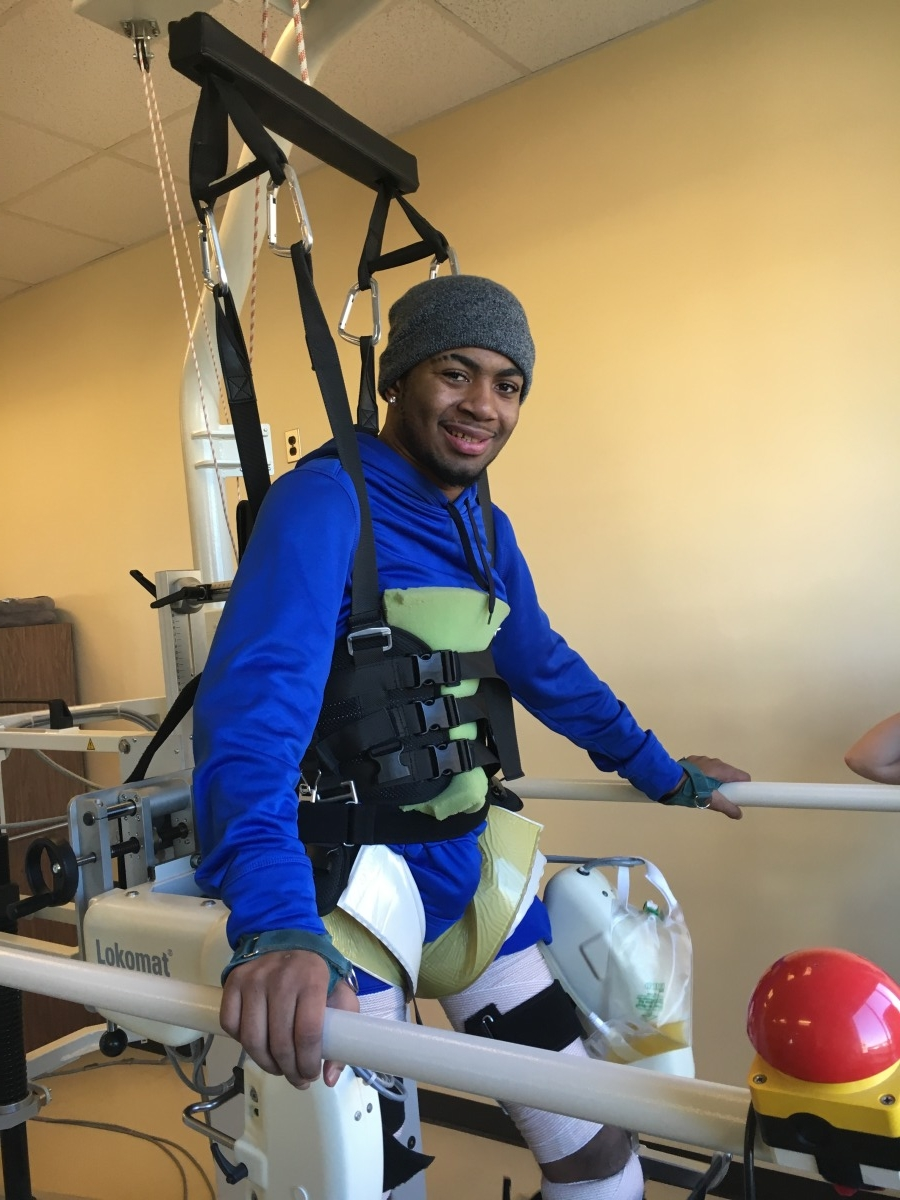 A smiling Devon Gales undergoes physical therapy at the Shepherd Center in Atlanta