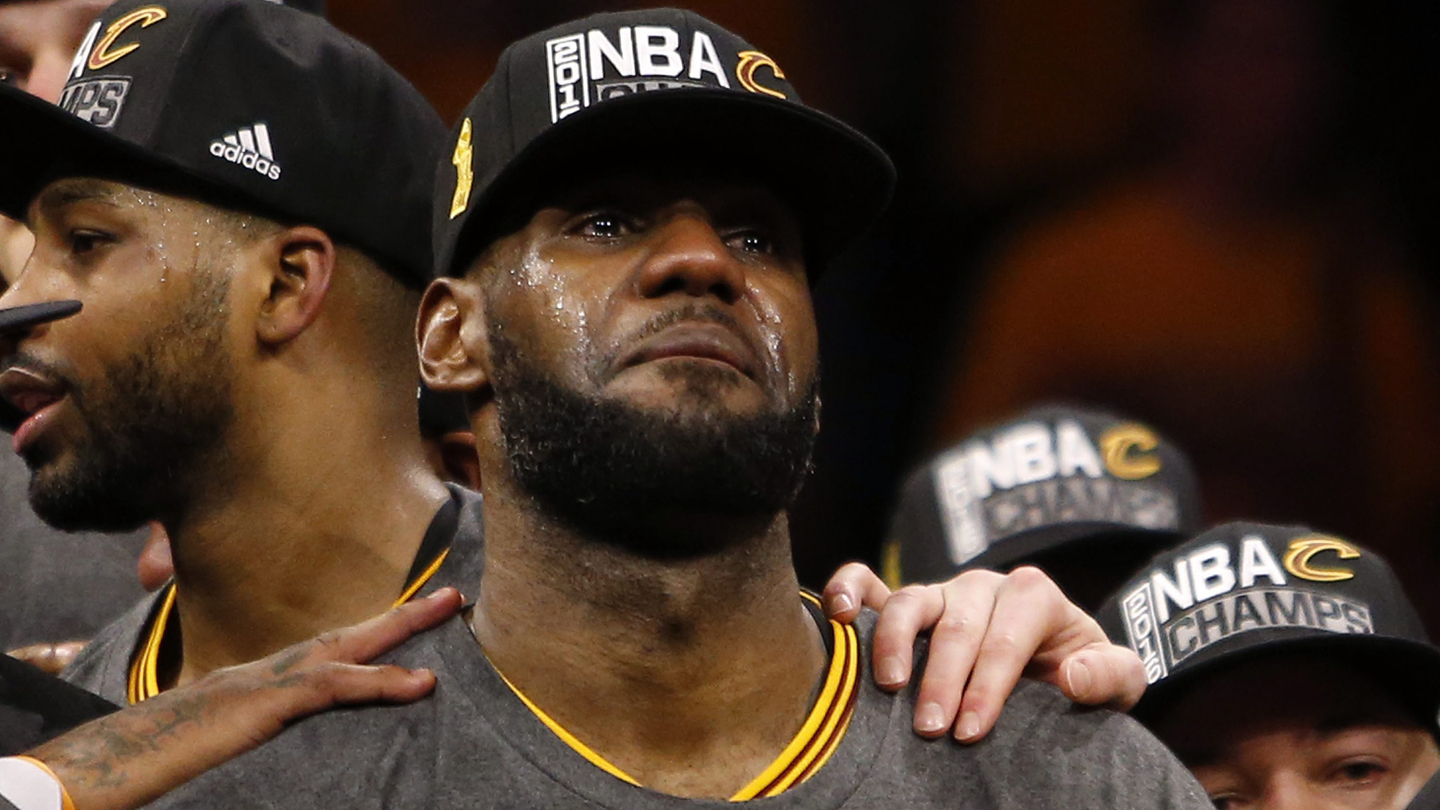 Cleveland Cavaliers forward LeBron James cries as he holds the trophy after the Cavaliers bet the Golden State Warriors during their NBA Finals game seven at Oracle Arena in Oakland, California, USA, 19 June 2016.
