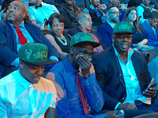 Matur Maker sitting in the stands at the 2016 NBA Draft.