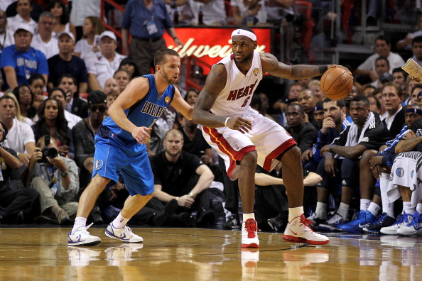 MIAMI, FL - JUNE 12: LeBron James #6 of the Miami Heat posts up against Jose Juan Barea #11 of the Dallas Mavericks in Game Six of the 2011 NBA Finals at American Airlines Arena on June 12, 2011 in Miami, Florida. The Mavericks won 105-95. NOTE TO USER: User expressly acknowledges and agrees that, by downloading and/or using this Photograph, user is consenting to the terms and conditions of the Getty Images License Agreement. (Photo by Mike Ehrmann/Getty Images)