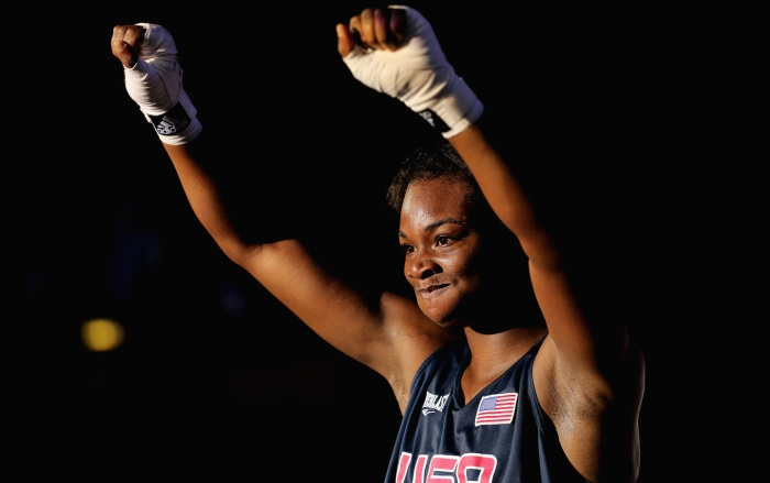 Claressa Shields of the United States celebrates her victory against Marina Volnova of Kazakhstan during the Women's Middle (75kg) Boxing semifinals on Day 12 of the London 2012 Olympic Games at ExCeL on August 8, 2012 in London, England.