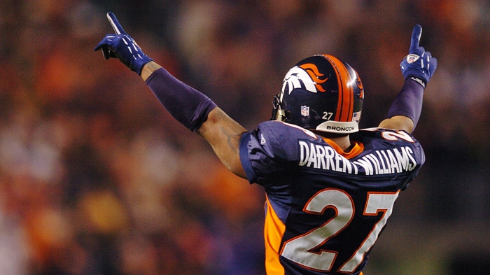 1_14_06__BRONCOS_PATRIOTS__ DENVER, C0.___ Broncos Darrent Williams celebrates Champ Bailey's interception run during the third quarter of the game between the Denver Broncos and the New England Patriots at Invesco Field at Mile High on Saturday, Jan. 14t