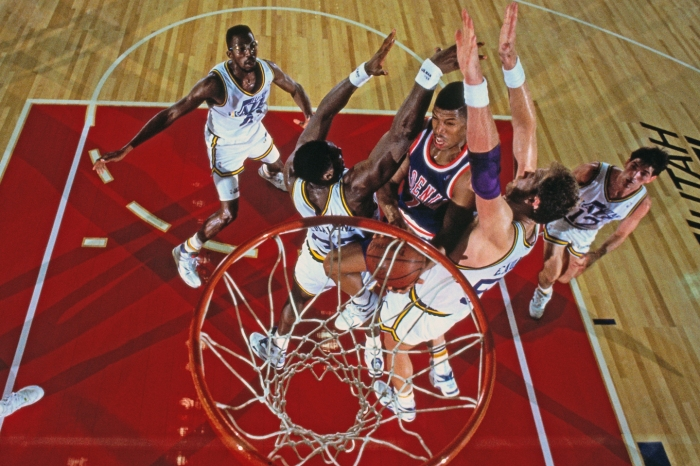 Kevin Johnson #7 of the Phoenix Suns shoots against the Utah Jazz during a game played on November 2, 1990 at the Tokyo Metropolitan Gymnasium in Tokyo, Japan.