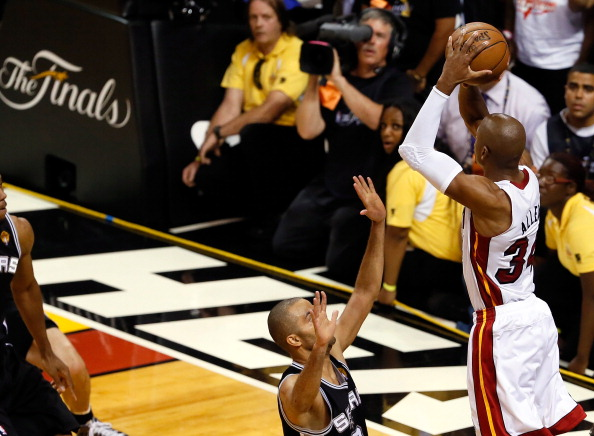 MIAMI, FL - JUNE 18: Ray Allen #34 of the Miami Heat makes a game-tying three-pointer over Tony Parker #9 of the San Antonio Spurs in the fourth quarter during Game Six of the 2013 NBA Finals at AmericanAirlines Arena on June 18, 2013 in Miami, Florida. NOTE TO USER: User expressly acknowledges and agrees that, by downloading and or using this photograph, User is consenting to the terms and conditions of the Getty Images License Agreement. (Photo by Kevin C. Cox/Getty Images)