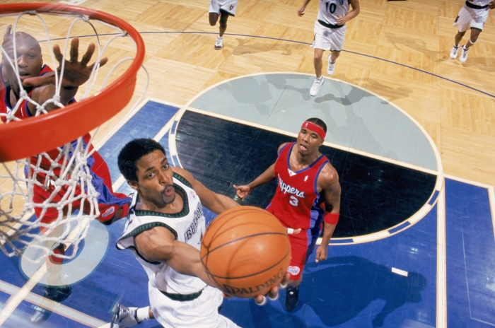 Rod Strickland #1 of the Minnesota Timberwolves goes for the reverse layup during the game against the Los Angeles Clippers at Target Center on January 24, 2003 in Minneapolis, Minnesota. The Timberwolves defeated the Clippers 88-85.