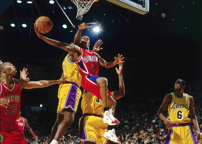 Allen Iverson #3 of the Philadelphia 76ers battles to the basket for an ally-oop layup against the Los Angeles Lakers at the Staples Center during the 1997 NBA season in Los Angeles, California.