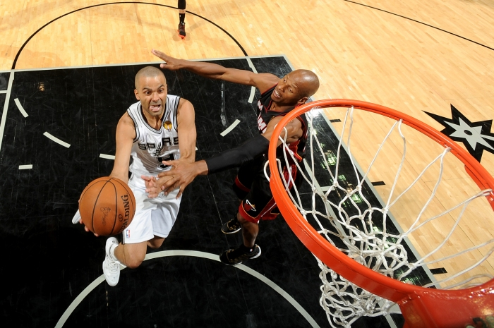 Tony Parker #9 of the San Antonio Spurs shoots against Ray Allen #34 of the Miami Heat during Game Five of the 2014 NBA Finals between the Miami Heat and San Antonio Spurs at AT&T Center on June 15, 2014 in San Antonio, Texas.