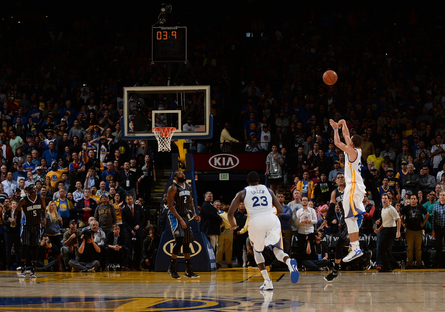 Stephen Curry #30 of Golden State Warriors takes a shot as time runs down against the Orlando Magic on December 2, 2014 at Oracle Arena in Oakland, California.