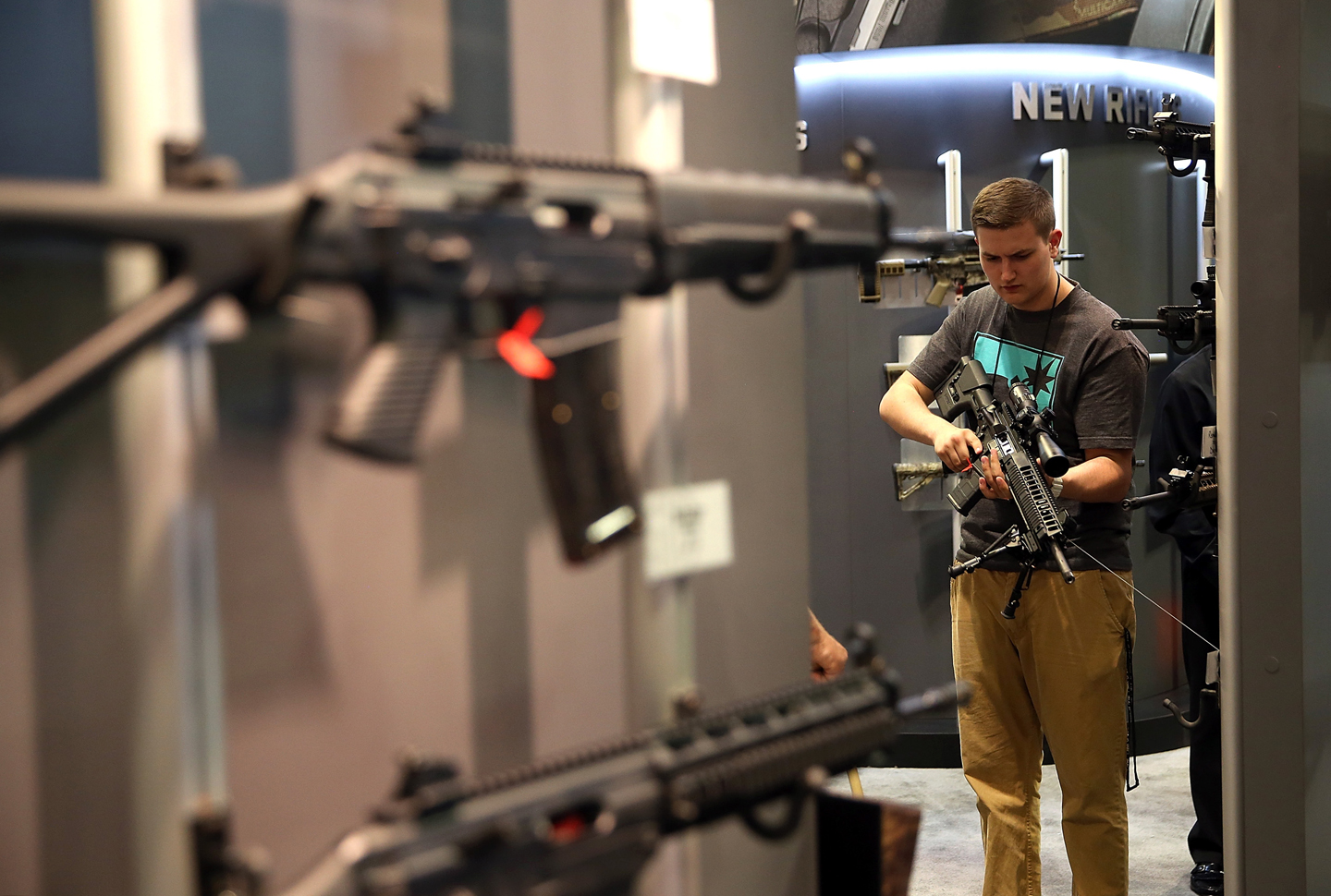 6df7ebbbbbd98d An attendee inspects an assault rifle during the 2015 NRA Annual Meeting    Exhibits on April 10