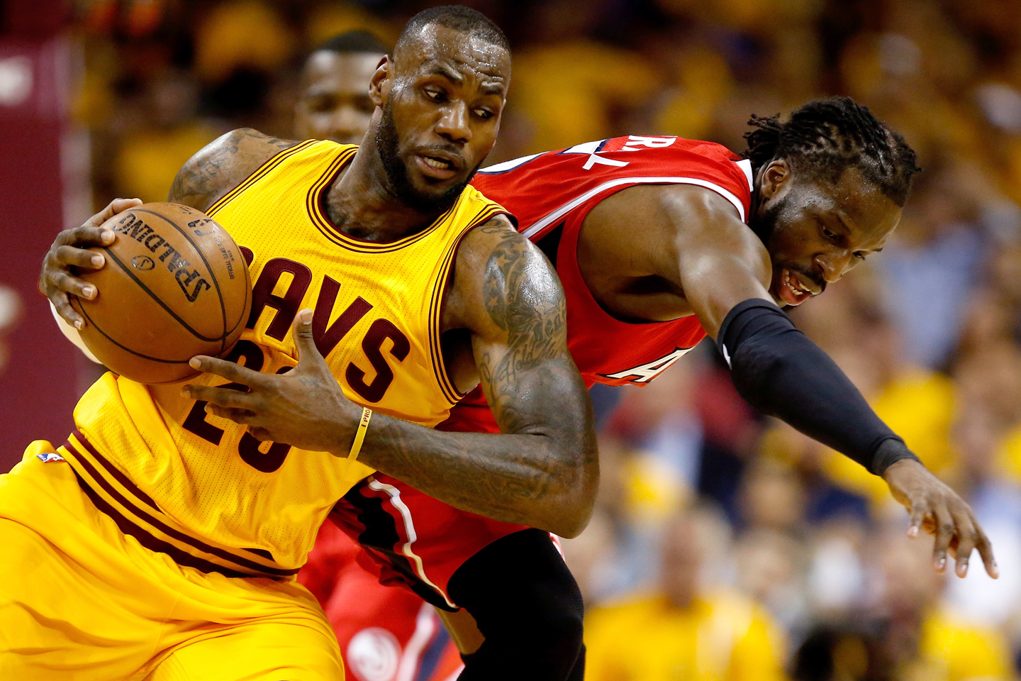 a5fc702a5a1b LeBron James  23 of the Cleveland Cavaliers battles for the ball with  DeMarre Carroll  5 of the Atlanta Hawks in the first quarter during Game  Four of the ...