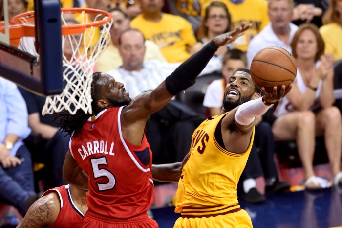 Kyrie Irving #2 of the Cleveland Cavaliers drives to the basket against DeMarre Carroll #5 of the Atlanta Hawks in the first half during Game Four of the Eastern Conference Finals of the 2015 NBA Playoffs at Quicken Loans Arena on May 26, 2015 in Cleveland, Ohio.
