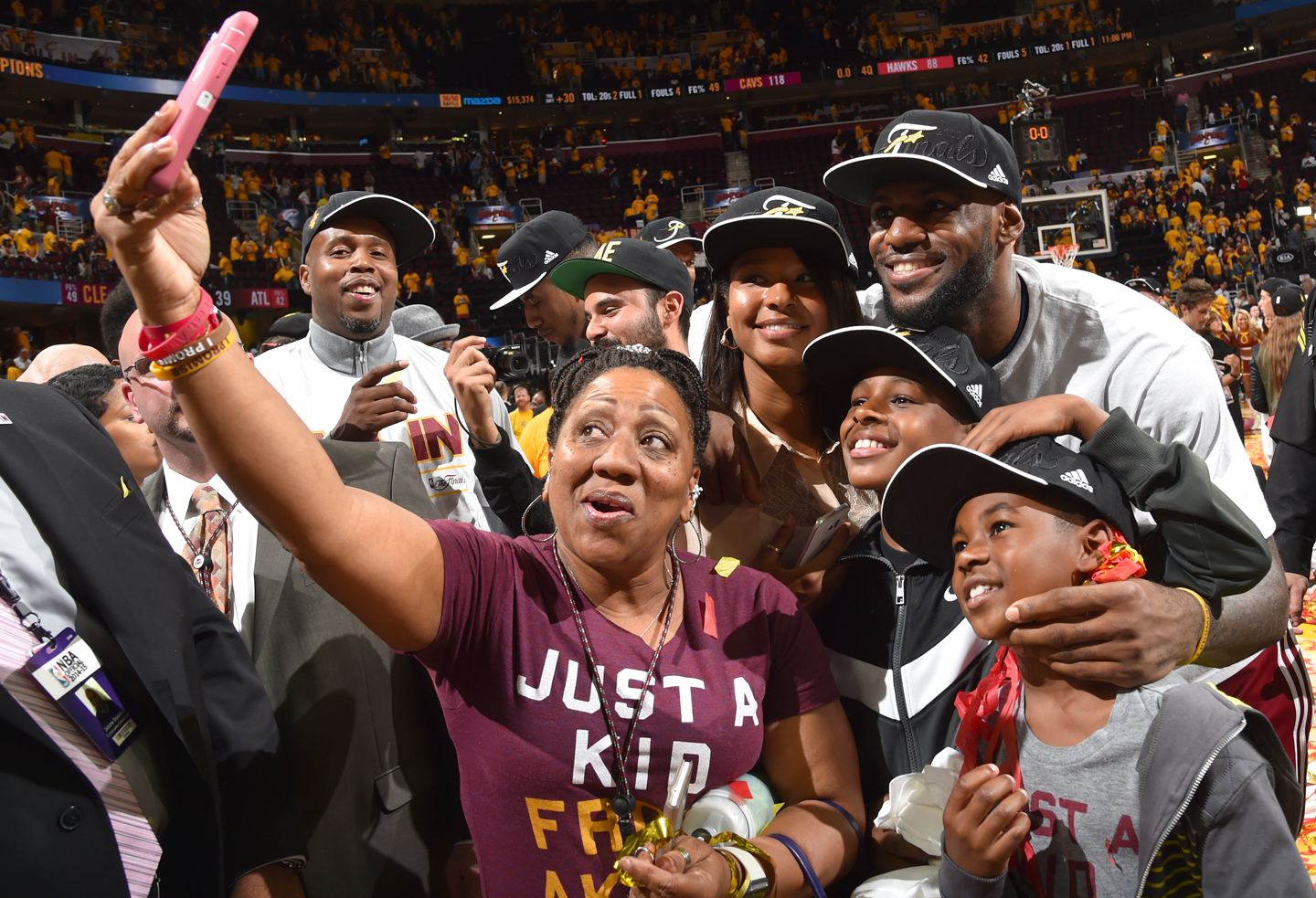 LeBron James #23 of the Cleveland Cavaliers takes a selfie with his family after winning game four against the Atlanta Hawks at the Quicken Loans Arena During Game Four of the Eastern Conference Finals during the 2015 NBA Playoffs on May 26, 2015 in Cleveland,Ohio