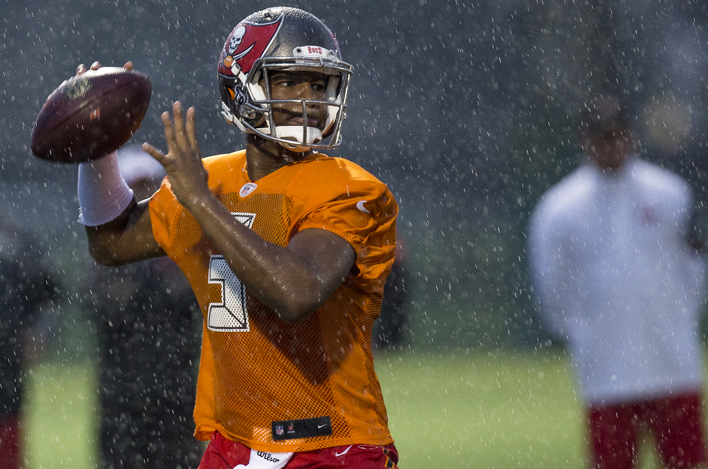 Quarterback Jameis Winston #3 of the Tampa Bay Buccaneers on a pass play during the first day of Training Camp at the University of South Florida on August 1, 2015 in Tampa, Florida.