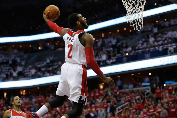 John Wall #4 of the Washington Wizards drives to the basket for a dunk in first quarter action of Game 3 of the Eastern Conference Quarterfinals against the Chicago Bulls during the 2014 NBA Playoffs at the Verizon Center on April 25, 2014 in Washington, DC.