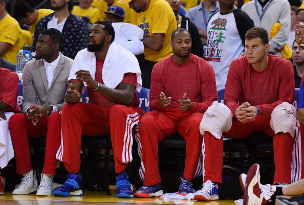 OAKLAND, CA - APRIL 27: Los Angeles Clippers players sit on the bench wearing their warm-up tops inside out against the Golden State Warriors in Game Four of the Western Conference Quarterfinals during the 2014 NBA Playoffs at ORACLE Arena on April 27, 2014 in Oakland, California. The players wore theirs warm up this way in protest of owner Donald Sterling's racially insensitive remarks. NOTE TO USER: User expressly acknowledges and agrees that, by downloading and or using this photograph, User is consenting to the terms and conditions of the Getty Images License Agreement. (Photo by Thearon W. Henderson/Getty Images)