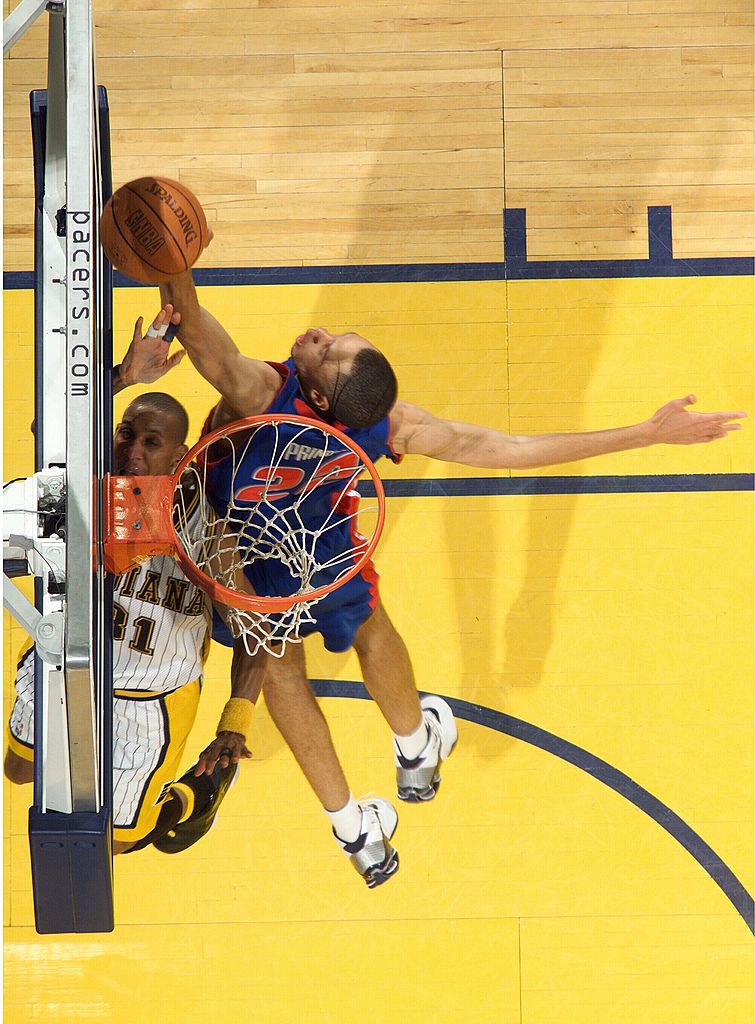 INDIANAPOLIS - MAY 24: Tayshaun Prince #22 of the Detroit Pistons blocks a shot attempt by Reggie Miller #31 of the Indiana Pacers in the final minutes of the 4th quarter to help seal a 72-67 victory for the Pistons in Game two of the Eastern Conference Finals during the 2004 NBA Playoffs on May 24, 2004 at Conseco Fieldhouse in Indianapolis, Indiana. NOTE TO USER: User expressly acknowledges and agrees that, by downloading and or using this photograph, User is consenting to the terms and conditions of the Getty Images License Agreement. Copyright 2004 NBAE (Photo by Ron Hoskins/NBAE via Getty Images)