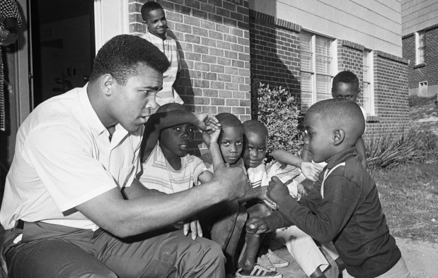 Cassius Clay Sparring with Young Boy