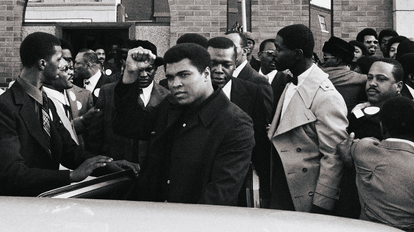 Muhammad Ali Exiting Car on Visit to Temple