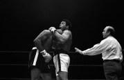 Muhammad Ali Holding Earnie Shavers