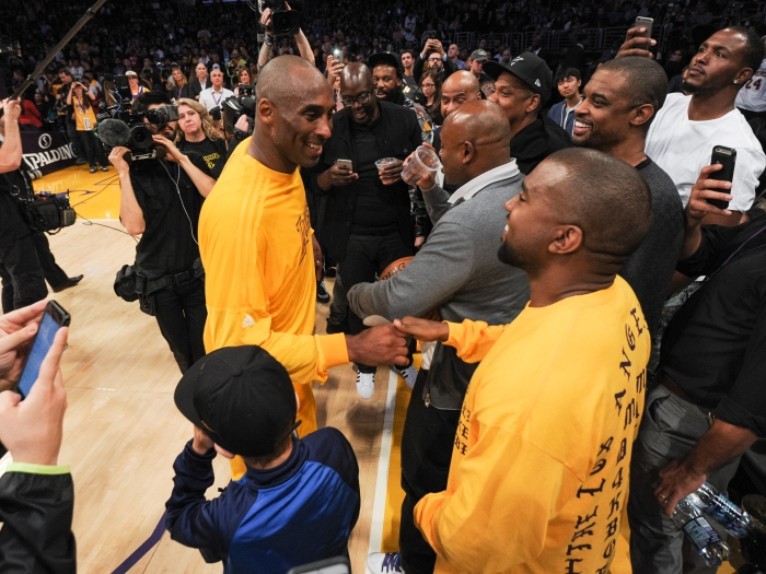 LOS ANGELES, CA - APRIL 13: Kanye West (R) greets Kobe Bryant at a basketball game between the Utah Jazz and the Los Angeles Lakers at Staples Center on April 13, 2016 in Los Angeles, California.